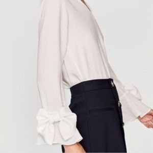 Zara V neck blouse with bow on sleeves.